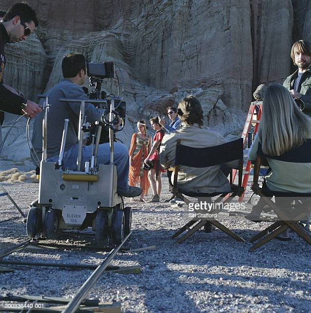 film crew shooting in desert - film director stock pictures, royalty-free photos & images