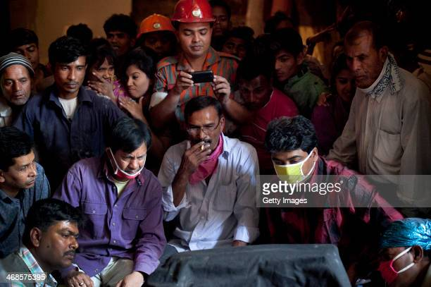 Film crew watches a take of the movie titled Rana Plaza during filming February 7, 2014 in Dhaka, Bangladesh. The movie tells the love story of a...