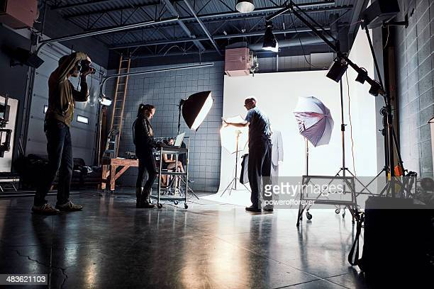 film crew working on set - cinematographer stock pictures, royalty-free photos & images