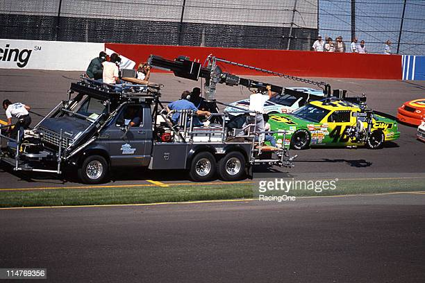 A film crew works on a scene from the movie Days of Thunder at Phoenix International Raceway The film was released later in the year and starred Tom...