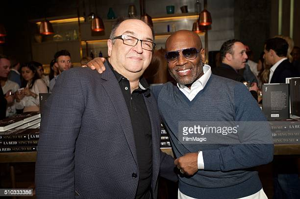 Film Critic Roger Friedman and Music Executive LA Reid pose for a photo at the LA Reid 'Sing To Me' PreGrammy Brunch at Hinoki The Bird on February...