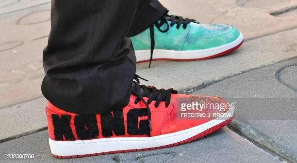 """Film director Adam Wingard's """"King Kong"""" shoes during the reopening of the TCL Chinese Theater in Hollywood, California on March 29, 2021. - The four..."""