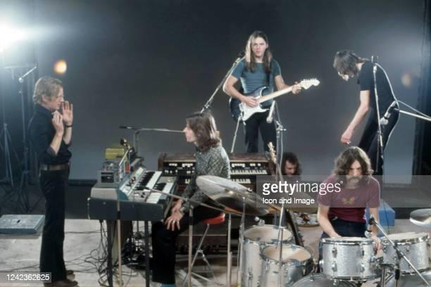 Film director Adrian Maben, keyboardist Richard Wright , guitarist, songwriter and lead singer David Gilmour, drummer Nick Mason and bassist, singer...