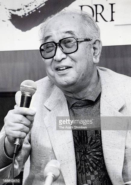 Film director Akira Kurosawa speaks during a press conference upon arrival after receiving the Academy Awards Special Honor Award at New Tokyo...