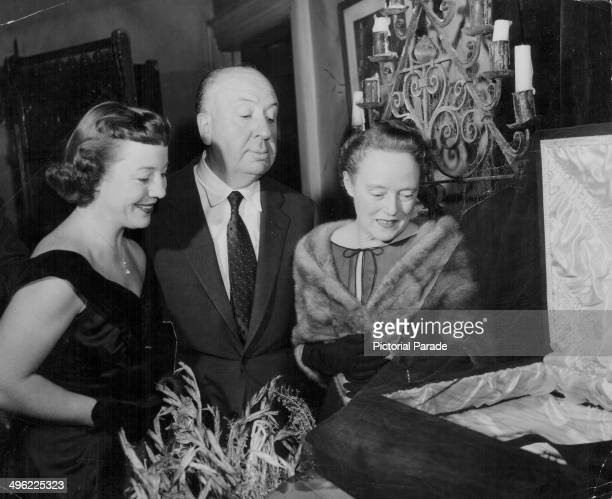Film director Alfred Hitchcock with his wife and daughter Patricia attending a haunted house party circa 19601965