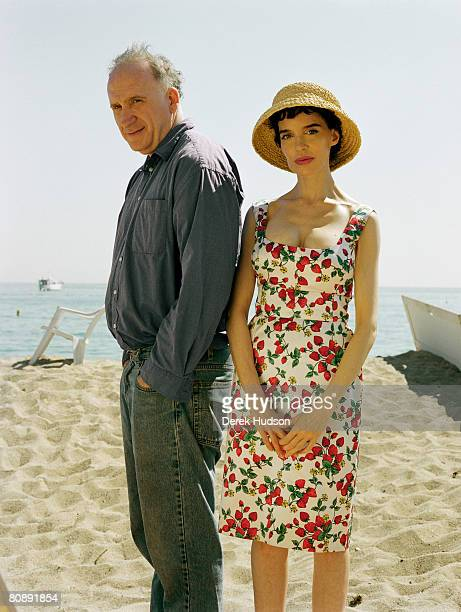 Film director Amos Kollek and actress Anna Thomson pose for a portrait shoot at Cannes Film Festival on May 20 2000 in Cannes France