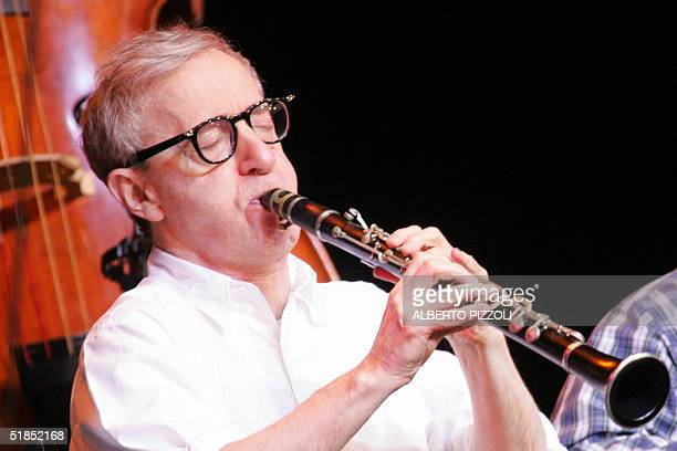 US film director and comedian Woody Allen performs during a clarinet concert in Rome's Sistina theatre 12 December 2004 Allen plays with the New...