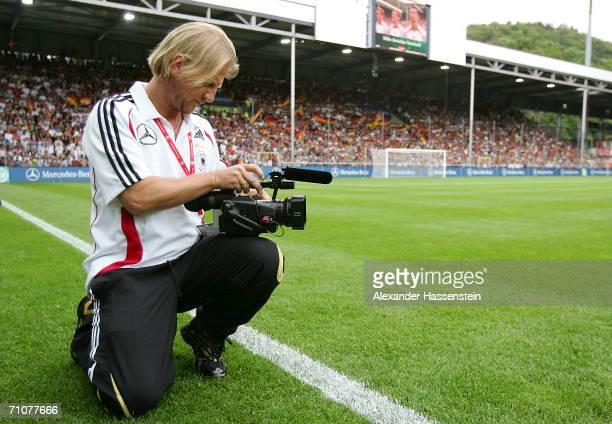 Film Director and former professional football player Soenke Wortmann films the German National Team during the friendly match between Germany and...