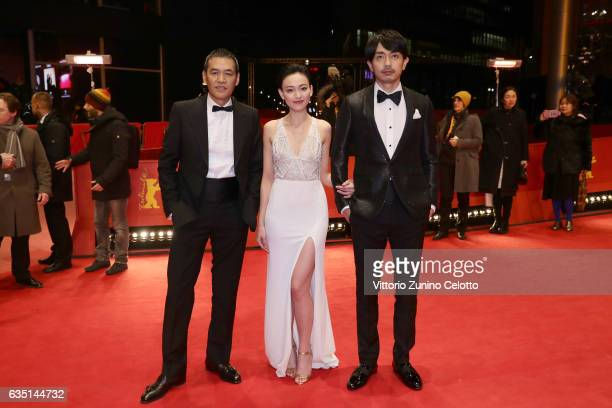 Film director and screenwriter Sabu actress Yeo Yi Ti and actor Chang Chen attend the 'Mr Long' premiere during the 67th Berlinale International Film...
