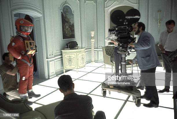 Film director and screenwriter Stanley Kubrick finds his shot on the set of '2001 A Space Odyssey' at the MGM British Studios in Borehamwood...