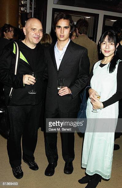 Film director Anthony Minghella his son Max and wife Carolyn Choa attend the 'Vanity Fair' Private Party at Dunhill on September 28 2004 in London