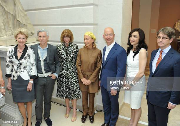 Film Director Baz Luhrmann EditorinChief of Vogue Anna Wintour and designer Miuccia Prada Amazon CEO Jeff Bezos attend the 'Schiaparelli And Prada...