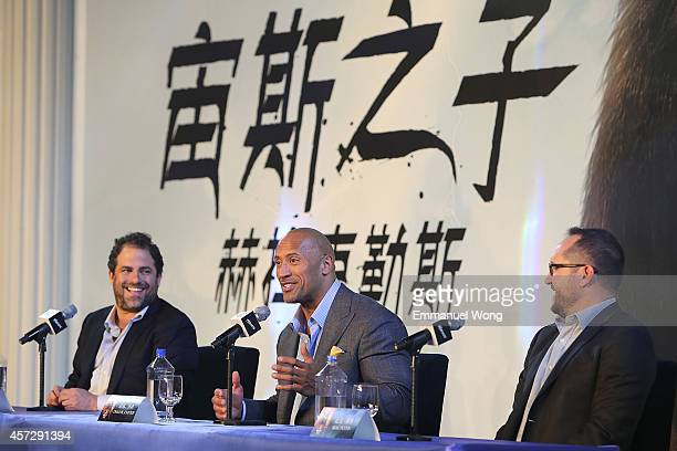 Film Director Brett Ratner actor Dwayne Johnson and producer Beau Flynn attend the press conference of Paramount Pictures 'HERCULES' at The China...