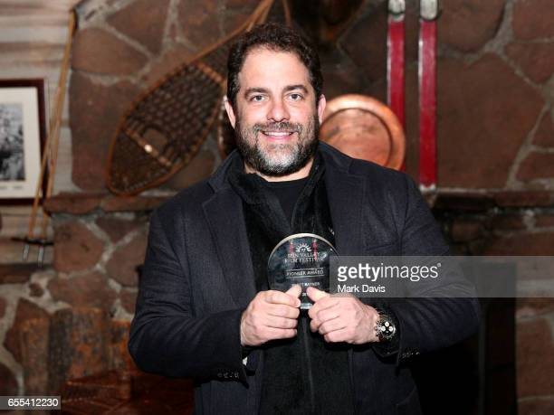 Film director Brett Ratner poses with the Sun Valley Film Festival 'Pioneer Award' on March 17 2017 in Sun Valley Idaho
