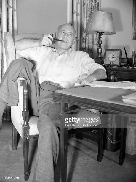 Film director Cecil B DeMille poses for a portrait in his Hollywood hills home circa 1940 in Los Angeles California