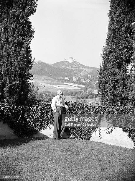 Film director Cecil B DeMille poses for a portrait inthe garden of his Hollywood hills home circa 1940 in Los Angeles California