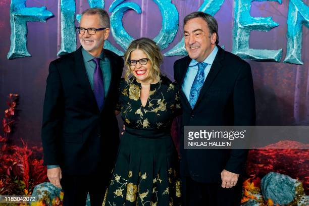 US film director Chris Buck US film director Jennifer Lee and US film producer Peter Del Vecho pose on the red carpet as they arrives to attend the...