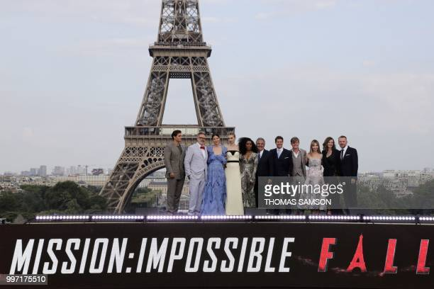US film director Christopher McQuarrie and Chief Executive Officer of Paramount Pictures Jim Gianopulos pose with members of the cast British actor...