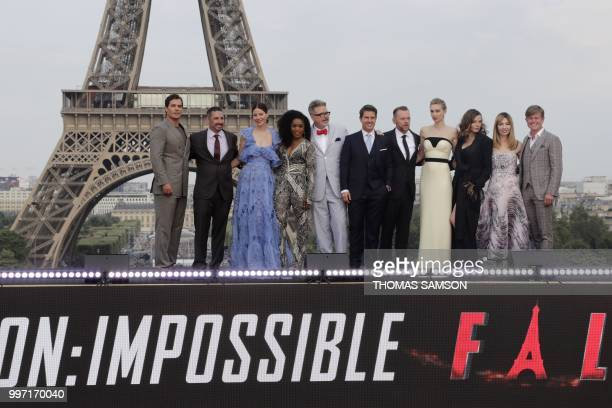 US film director Christopher McQuarrie and producer Jake Myers pose with members of the cast English actress Vanessa Kirby US actresses Michelle...
