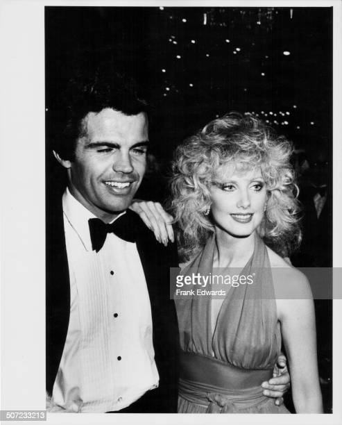 Film director Craig Denault and actress Morgan Fairchild attending the Annual Golden Globe Awards at the Beverly Hilton Hotel California January 1982