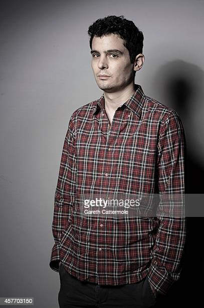 Film director Damien Chazelle poses in the portrait studio at the BFI London Film Festival 2014 on October 15 2014 in London England