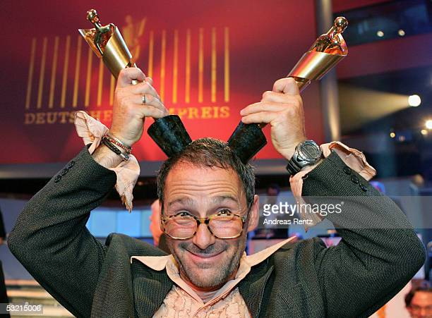 Film Director Dani Levy holds his Golden Lola awards for Best Director and Screenplay at the German Film Awards, the Deutscher Filmpreis, July 8,...