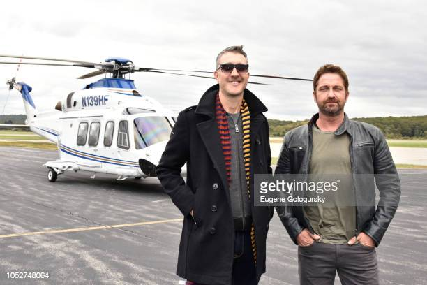 Film director Donovan Marsh and actor Gerard Butler arrive to Groton Airport during Hunter Killer cast visit to Naval Submarine Base New London on...