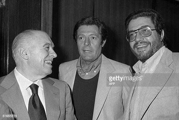"Film Director Ettore Scola , actor Marcello Mastroianni and producer Carlo Ponti smile to the camera, following the gala screening of ""Una Giornata..."