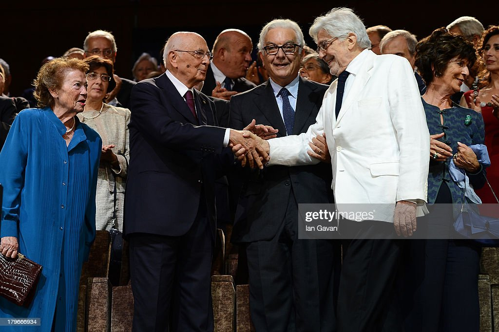 Film Director Ettore Scola (2nd-R) is greeted as his wife (R) looks on by President of La Biennale Paolo Baratta (C) Italian Presiden Giorgio Napolitano (2nd-L) and his wife Clio Maria Bittoni (L) before receiving the 'Jaeger-LeCoultre Glory To The Filmmaker 2013 Award' during the screening of 'Che Strano Chiamarsi Federico - Scola Raconta Fellini' Premiere during The 70th Venice Film Festival at Palazzo del Cinema on September 6, 2013 in Venice, Italy.