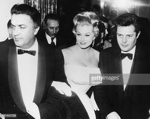 Film director Federico Fellini with actors Anita Ekberg and Marcello Mastroianni at the premiere of the film 'La Dolce Vita' in Rome, February 8th...