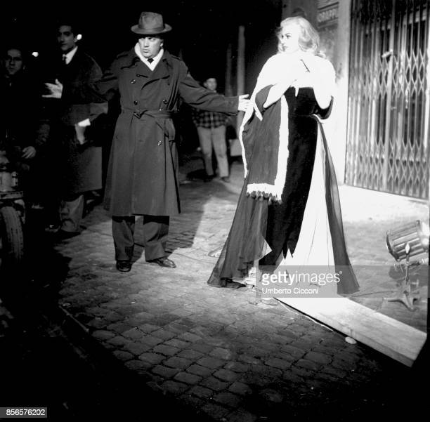 Film director Federico Fellini with actress Anita Ekberg during the shooting of movie 'La Dolce Vita' Rome 1959