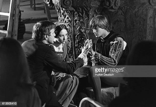 Film director Franco Zeffirelli directing Olivia Hussey and Leonard Whiting during the filming of Romeo and Juliet 1967