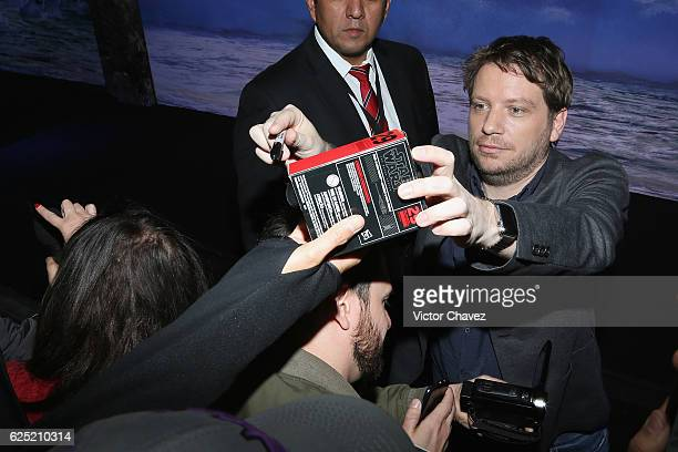 Film director Gareth Edwards signs autographs and takes selfies with fans during the Rogue One A Star Wars Story Mexico City fan event black carpet...