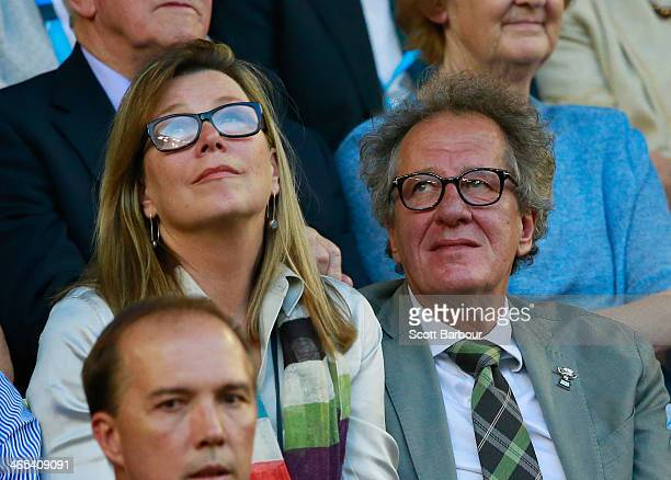 Film director Geoffrey Rush and his wife actress Jane Menelaus look on in the men's final match between Rafael Nadal of Spain and Stanislas Wawrinka...