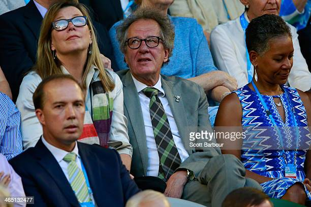 Film director Geoffrey Rush looks on in the men's final match between Rafael Nadal of Spain and Stanislas Wawrinka of Switzerland during day 14 of...