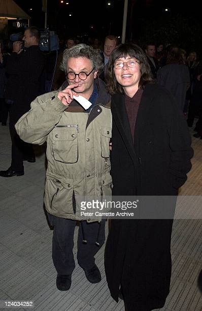 Film director George Miller and his wife arrive for the opening night of the Cirque du Soleil production of 'Alegria' under the Grand Chapiteau at...