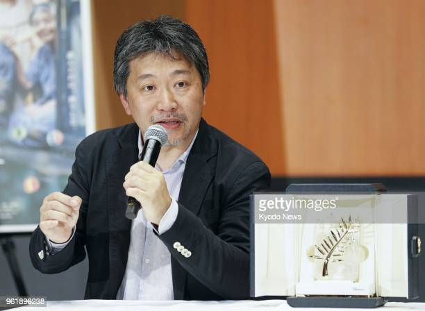 Film director Hirokazu Koreeda speaks during a press conference at Haneda airport in Tokyo on May 23 2018 Koreeda won the Palme d'Or at the annual...