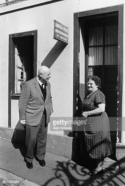 Film Director Jean Renoir Talking to His Caretaker