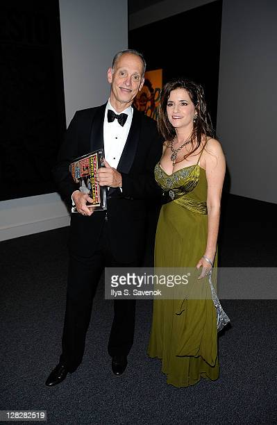 Film Director John Waters and Maria Elena Tierno attend the Warhol Headlines exhibition opening in the East Building at the National Gallery of Art...