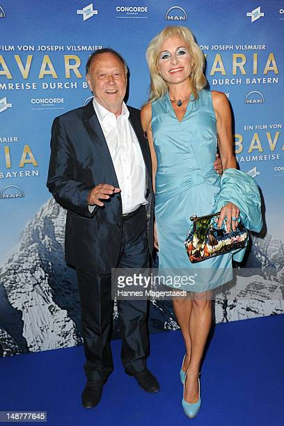 Film director Joseph Vilsmaier and his girlfriend Birgit Muth attend the 'Bavaria' Germany Premiere at the Mathaeser Filmpalast on July 19 2012 in...