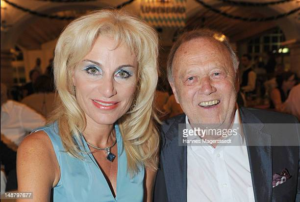 Film director Joseph Vilsmaier and his girlfriend Birgit Muth attend the 'Bavaria' Germany Premiere party at the Loewnbraeukeller on July 19 2012 in...