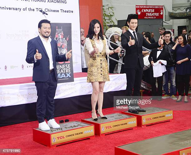 Film Director Justin Lin Actress Zhao Wei and Actor Huang Xiaoming participate in the TCL Chinese Theatre Hand Footprint Ceremony at Bruno Wu and...