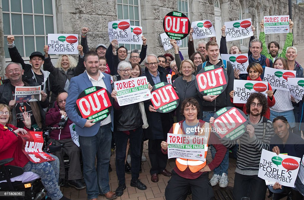 Film director Ken Loach and Natalie Bennett, former leader of the Green Party (C) gather with anti-austerity and anti-Tory activists outside the People's Assembly's People Conference which is being held in Birmingham Town Hall ahead of a demonstration tomorrow on on October 1, 2016 in Birmingham, England. Conservative Party members began gathering today ahead of the four day conference which will begin tomorrow.