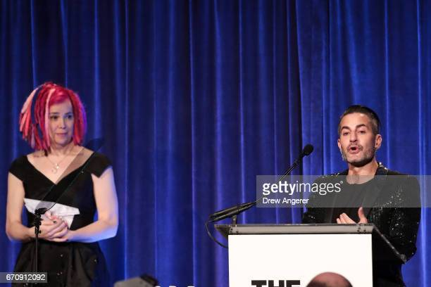 Film director Lana Wachowski looks on as fashion designer Marc Jacobs speaks at LGBT Center dinner April 20 2017 in New York City Jacobs was awarded...