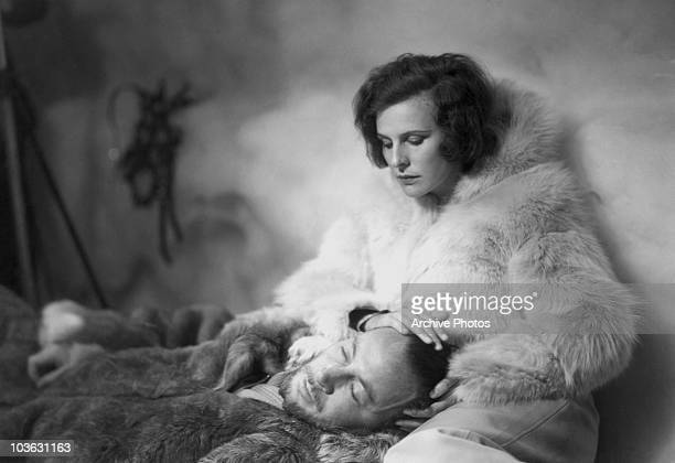 Film director Leni Riefenstahl pictured wearing a white fur coat while resting her hand on a man's head, Germany, circa 1940. Riefenstahl's most...