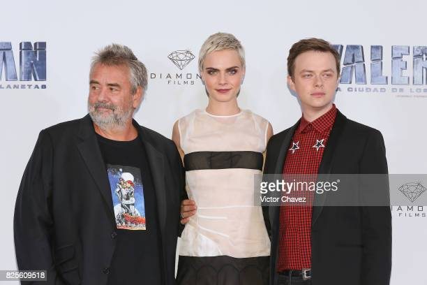 Film director Luc Besson actress Cara Delevingne and actor Dane DeHaan attend a photocall to promote their new film 'Valerian And The City Of A...