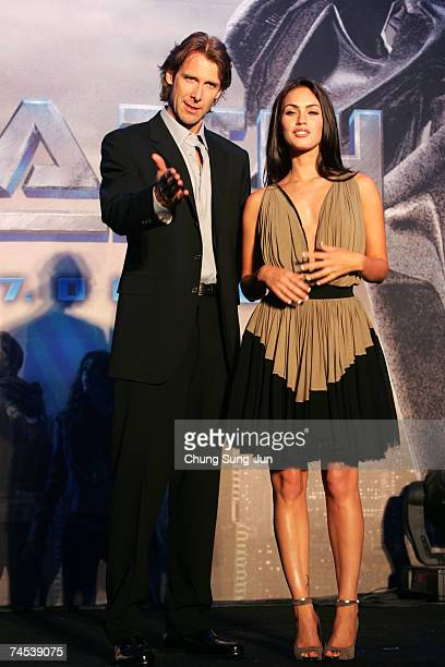 S film director Michael Bay and actress Megan Fox attend a photocall before a press conference to promote their new film Transformers on June 11 2007...