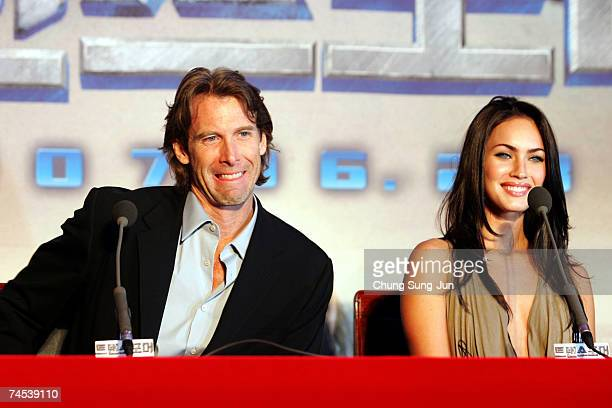 S film director Michael Bay and actress Megan Fox attend a press conference to promote their new film Transformers on June 11 2007 in Seoul South...