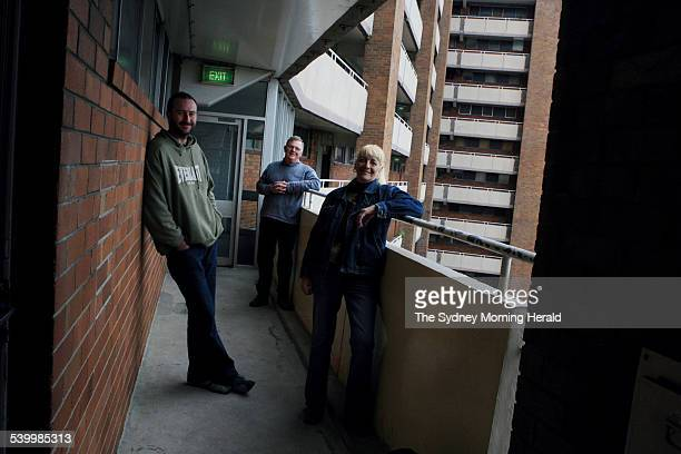 Film director of '900 neighbours' Brendan Fletcher left and producer Frank Haines right with Northcott Towers resident Sandy Henderson centre in...