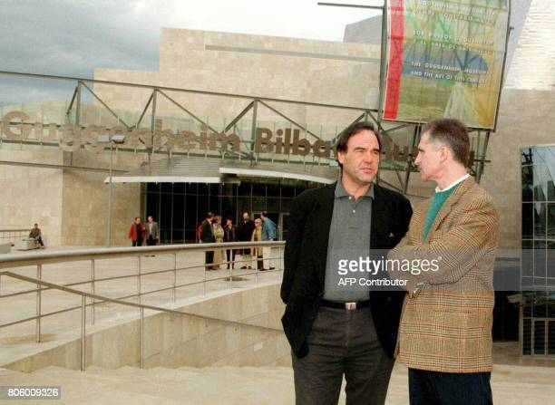 US film director Oliver Stone with Guggenheim Museum director Juan Ignacio Vidarte outside the building in Bilbao which Stone visited 18 January /...